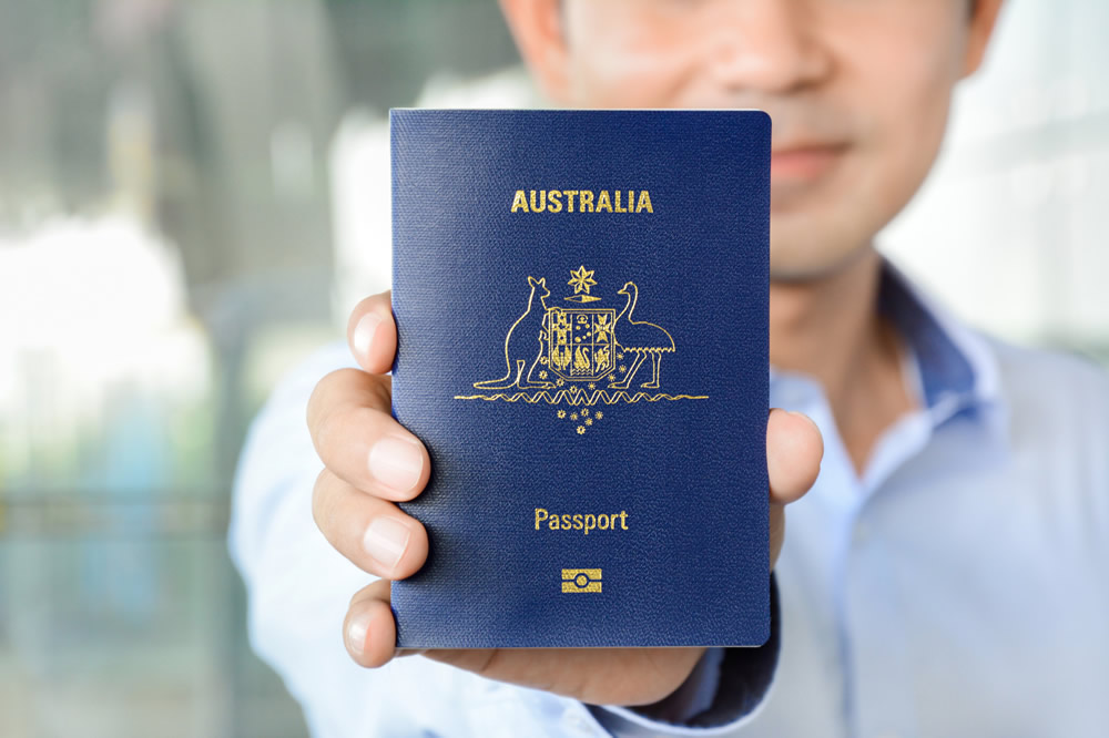 New Australian citizenship man showing passport
